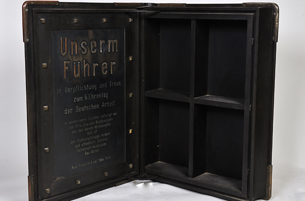 "Inside This is the cabinet's inside. The inscription: ""To our leader, with duty and loyalty on the 6th day honoring German work."""