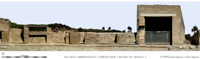 This image of Regio III, Insula 3 created by Jennifer and Arthur Stephens as part of the Via dell'Abbondanza Project (www.pompeiiperspectives.org), shows the Schola Armaturarum (doorway 6, on the right) as it appeared in 2009.  The photomosaic was made by combining multiple digital images and a total station survey of the facade of the city block.  The completed photomosaics are at a scale of 1:25 @ 300 ppi.  The project is documenting all 32 insulae along the 900 meter-long street for the archives in Pompeii and future publication.