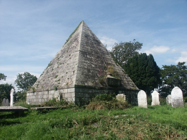 Figure 1: A view of the pyramid erected in 1785 as a mausoleum for the Howard family of nearby Shelton Abbey.  Described in 2001 as a valuable piece of heritage at risk of being lost through neglect and decay, the pyramid was adopted as a project by the Arklow Marine and Heritage Committee who, in partnership with TÚS, have begun a careful restoration of the mausoleum